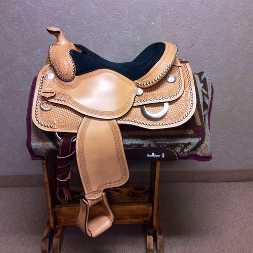 "16"" Dale Chavez Dot Reining Saddle - These saddles have a classy look even for western pleasure, so they are a great multi purpose Saddle. Skirt cut out for close contact, stirrups are pre-turned, along with the great dot and Barbwire boarder, and basket weave tooling. Nice equitation seat measures 17"" to the the stitching, with the sitting pocket being 16"". Don't miss these, our riding season is right around the corner."