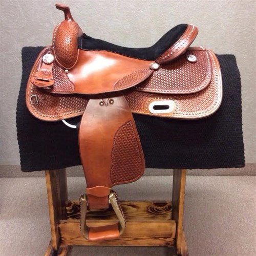 "16"" RS Custom Dot Show Saddle Chestnut-***3 IN STOCK*** The RS Custom Dot Show Saddle is built on our popular #2206 'Training Tree' this tree is known for its unmatched comfort for both horse and rider. This saddle will help you naturally stay in the correct position to enjoy the ride! Limited Quantities Available."