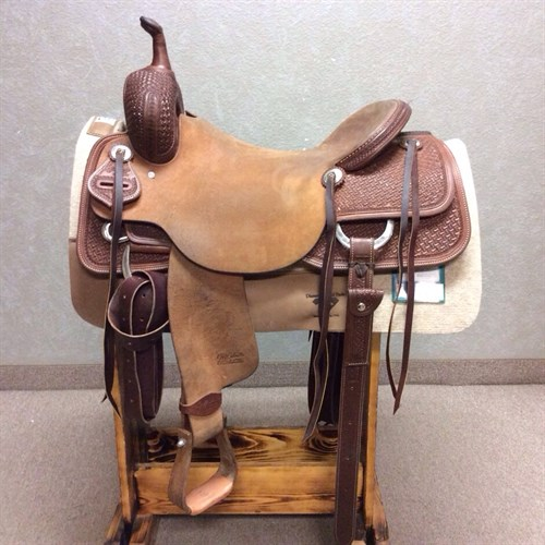 """17"""" Jeff Smith Cutting Saddle - This lightly used Cutting Saddle is a great buy! The rough out seat has a nice stick to it. Handily crafted with quality leather, pre-turned fenders, complete back cinch, and Nettles stirrups."""