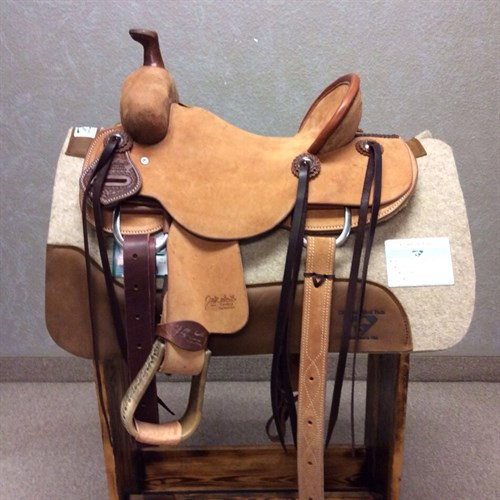 "12"" (3 IN STOCK) Jeff Smith Kid Saddle - Made with the same materials and trees of the adult saddles! Great youth saddle sits a nice deep seat with rough out jockey and fenders, stainless steel conchos with saddle strings, and matching back cinch. #10"