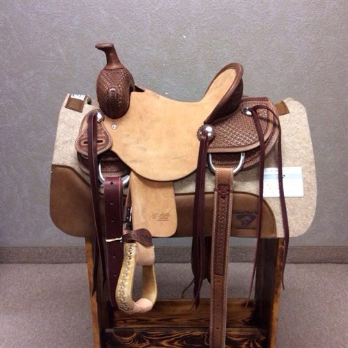 "12"" Jeff Smith Kid Saddle - Made with the same materials and trees of the adult saddles! Great youth saddle sits a nice deep seat with rough out jockey and fenders, stainless steel conchos with saddle strings, and matching back cinch. #12"