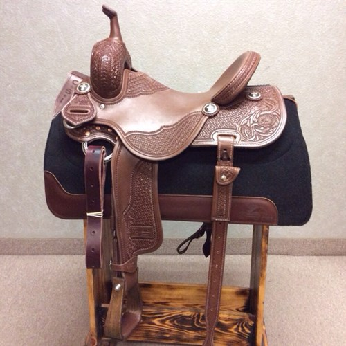 "15"" Jeff Smith Barrel Saddle - Made with quality Herman Oak leather, heavy oiled, intricate double geo tooling with floral tooled corner, with great attention to detail. Built on a BW tree (wood tree dipped in fiberglass) this barrel saddle has a 9"" (height) front end, it allows for a deeper pocket in addition to the 5"" cantle height! The seat of this saddle sits you deep on your pockets, the forward/free swinging stirrups allow you to set your feet naturally in front of you. JSB 34"