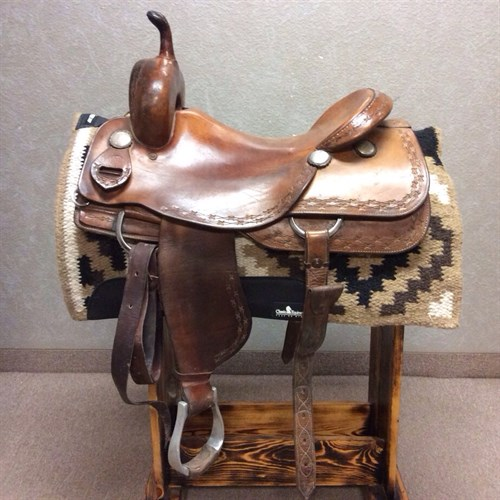 """16.5"""" Roo Hide Cutting Saddle - Ready to used cutting saddle smooth out seat jockey and fenders. Boarder tooled with barbwire. Comes with aluminum stirrups, latigo and off billet."""