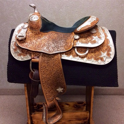 """15.5"""" Silver Mesa - Beautifully crafted show saddle made with the finest quality overseen by Denny Sergeant himself. This Silver Mesa was marked at $12,000 NEW here is your chance to own this breathtaking quality show saddle. It is in great condition star studded with fine silver, hand tooled with oak leaf tooling, and finished with a silver horn. (C)"""