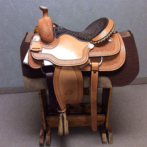 """15.5"""" Billy Cook #2146 - Special features include a uniquely quilted seat, hand tooled swell, and 21 strand roper cinch. The leather is waffle stamped with a basket design and running W border and oiled to finish. (#2146)"""