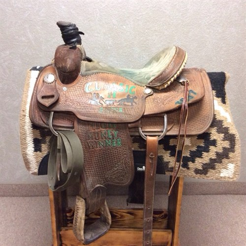 """14.5"""" Double J Roper - Great quality rope saddle made by Double J. If you are just starting out or need an extra saddle in the tack room this is a great one to have. 14.5"""" suede padded seat with rawhide laced cantle, quality roper stirrups, complete with wide back cinch."""