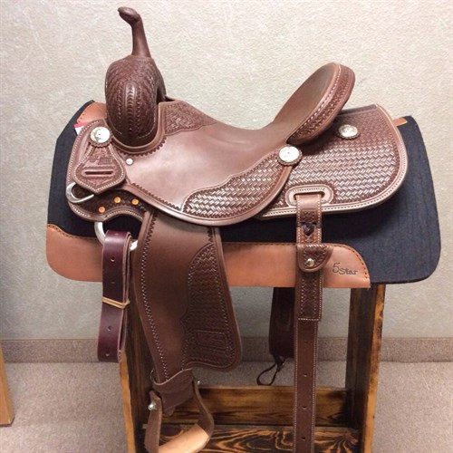 "14.5"" Jeff Smith Barrel - Made with quality Herman Oak leather, heavy oiled, intricate long basket weave tooling, with great attention to detail. Built on a BW tree (wood tree dipped in fiberglass) this barrel saddle has a 9"" (height) front end, it allows for a deeper pocket in addition to the 5"" cantle height! The seat of this saddle sits you deep on your pockets, the forward/free swinging stirrups allow you to set your feet naturally in front of you. JSB 37"