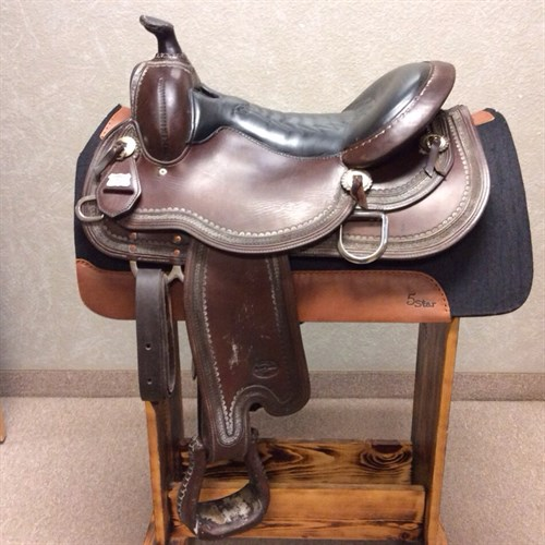 """15"""" Reinsman Trail Saddle - Heavily padded black leather seat that is extremely comfortable. This saddle is well made with soft supple leather and stainless steel hardware. This saddle has a great feel and is comfortable for you and the horse."""