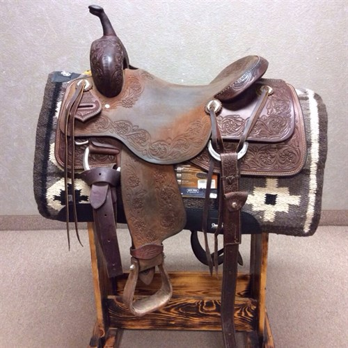 """16"""" Jeff Smith Cutting Saddle - Nice quality used Jeff Smith Cutter the floral tooled rough out gives it a unique look this saddle is built on a Buster Welch Tree sits a 9"""" Front end. High quality saddle made with stainless steel hardware, nettles stirrups, and upgraded conchos. (C-145)"""