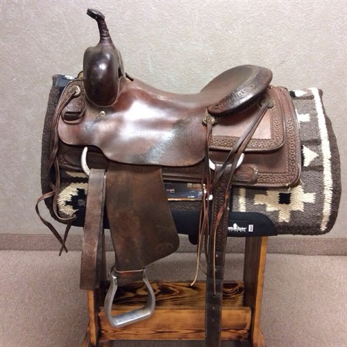 """16.5"""" Billy Cook Cutting Saddle - Lots of rides left in this quality Billy Cook cutter. This smooth seated boarder tooled saddle includes antique conchos, metal stirrups, and back cinch."""