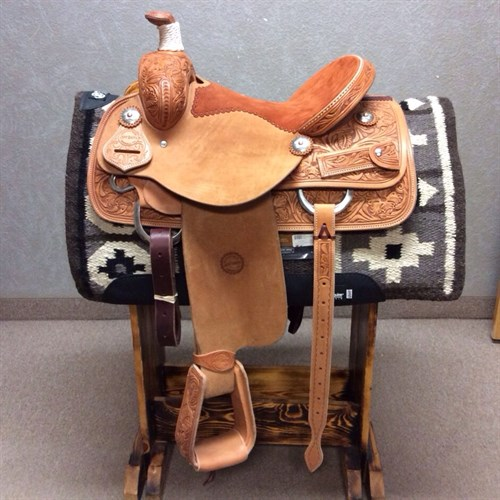 "14.5"" Jeff Smith Roping Saddle - This light oil Jeff Smith 14.5"" roper features floral & oak leaf tooling, stainless steel hardware, drop down rigging, rust suede seat, 6"" matching back cinch, leather tooled traditional roper stirrups, and cowpuncher custom conchos. Quality made saddle ready to use! JSR-2"