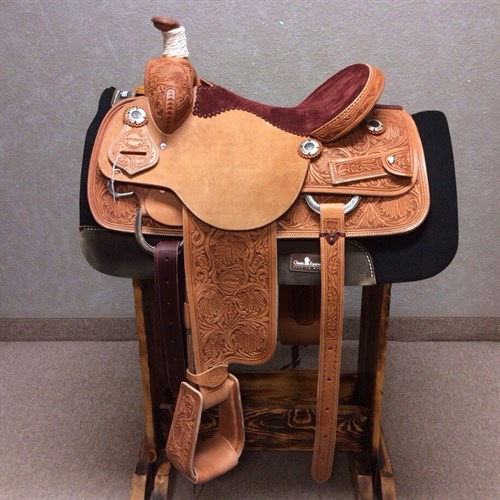 "15"" Jeff Smith Roping Saddle - This light oil Jeff Smith 15"" roper features floral & oak leaf tooling, stainless steel hardware, drop down rigging, maroon suede seat, 6"" matching back cinch, leather tooled traditional roper stirrups, and cowpuncher custom conchos. Quality made saddle ready to use! JSR-3"