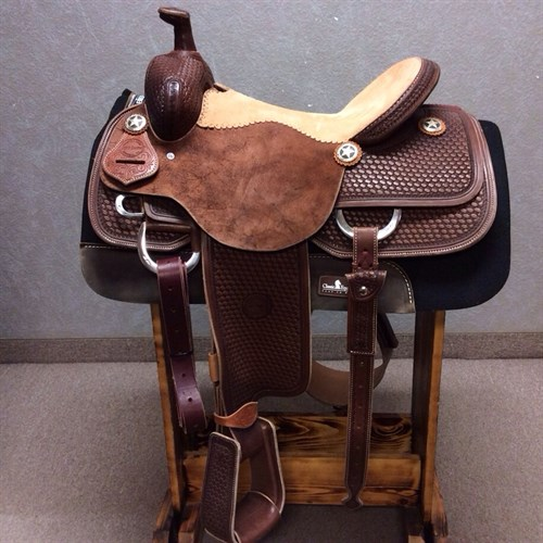 "16"" Jeff Smith Roping Saddle - This chocolate oil Jeff Smith 16"" roper features baskey weave tooling, stainless steel hardware, drop down rigging, rust suede seat, 6"" matching back cinch, leather tooled traditional roper stirrups, and cowpuncher custom conchos. Quality made saddle ready to use! JSR-4"