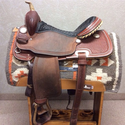 """15.5"""" Billy Cook #1530 - Suede seat, rough out jockey and fender. Great barrel saddle with nice deep pocket and tall front end. Complete with back cinch and rawhide stirrups."""