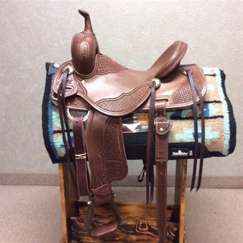 "14.5"" Jeff Smith Barrel - Made with quality Herman Oak leather, heavy oiled, intricate long geo tooling, with great attention to detail. Built on a BW tree (wood tree dipped in fiberglass) this barrel saddle has a 9"" (height) front end, it allows for a deeper pocket in addition to the 5"" cantle height! The seat of this saddle sits you deep on your pockets, the forward/free swinging stirrups allow you to set your feet naturally in front of you. JSB 38"