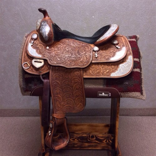 """Nice used Bob's Custom show saddle! Here's a chance to own one of the best. It's a 1995 model in excellent condition, nicely broke in and still has alot of years left!! the silver on these saddles will always polish up like brand new. This is a 16"""" seat, pocket sits more like 15 1/2"""". Don't miss an opportunity to have one of the best, price was just reduced!! Brand new this saddle is well over $5000.00"""