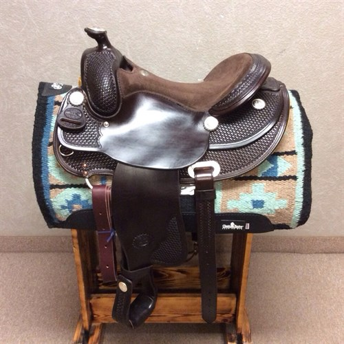 "Billy Cook saddle with that hard to find Arabian tree. Great darker color, round skirt for good comfortable fit, pre turned fenders for rider comfort and nice padded suede 15"" seat. Also rear cinch. Don't miss out on this hard to find saddle."