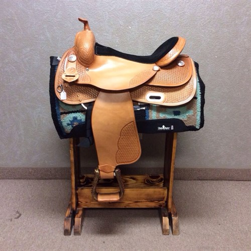 RS Show Saddle - available in 15.5 seat Nicely tooled with basket weave and some extra touches of silver, built on the #2206 tree (same as the training saddles) very comfortable and sit you well for the show pen!