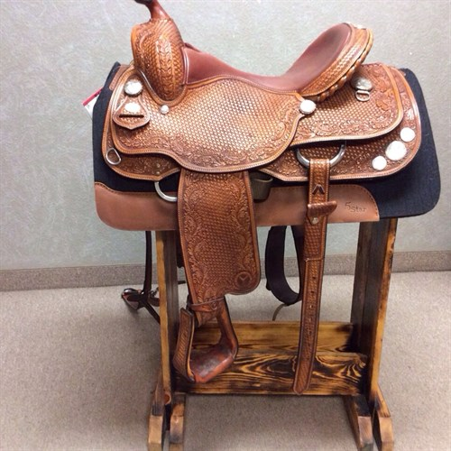 """16"""" Circle Y Reiner. This is one sharp looking saddle. Beautifully tooled with matching rear cinch and breast collar. (C)"""