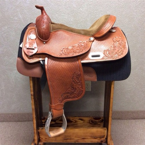 """15.5"""" RS Custom Saddle - Nicely made reining or trail saddle. Sits great for the rider keeping you in a great position to enjoy the ride. Pretty floral and basket weave tooling. Made with a wide shoulder flare to fit a nice range of horses. This is a great deal on a slightly used RS Saddle."""