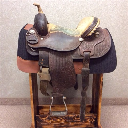 """14"""" Sharon Camarillo Barrel Saddle - Well made dark oil saddle with great supple leather. This saddle sits a 14"""" seat and has a 7"""" gullet, drop down style rigging. Rawhide wrapped horn slightly damaged."""