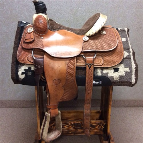 """15"""" #9111 Billy Cook Roper - If you're looking for a strong roper with some style, this 9111 might be right up your alley. Billy has designed this saddle on his rawhide covered wood tree with a strong on-tree full drop down rigging. A unique basket pattern sets off the russet finish from the pommel to the fenders and everywhere between."""