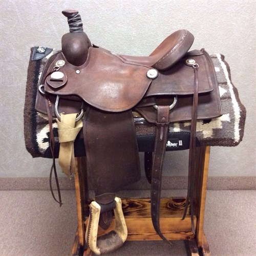 """15.5"""" Running P Ranch Cutter - Heavy oiled ranch cutting saddle nicely broke in and has a lot of use left! Rawhide stirrups, rubber wrapped horn, strings, and squared skirt. This saddle is ready to use!"""