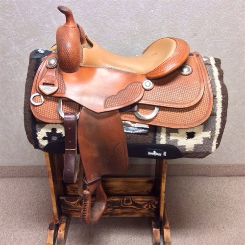 """Used Bob's Custom reining saddle. This is a 2008 Craig Schmersal, autographed by him! 16 1/2"""" seat great condition, padded seat per turned fenders, basket weave tooling, don't miss it for this price!"""