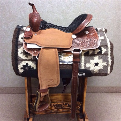 "16"" #1550 Billy Cook Barrel Saddle - This barrel racer by Billy Cook is the epitome of beauty and speed. It's built on a rawhide covered tree with Quarter horse bars and features a cheyenne roll 5"" cantle and roughout jockeys and fenders to give you a snug hold. The leather features a floral and basket design and the seat is uniquely quilted (and comfortable!)."