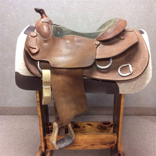 """16"""" Western Star Training Saddle - A ready to use training saddle with a great fit for both horse and rider! Suede seat, Basket weave tooling, and rough out."""
