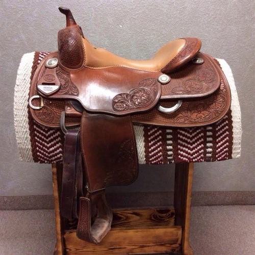 """16"""" Bob's Custom Jordan Larson Reining Saddle - Here is your chance to own a Bob's Custom Saddle at a great price! This 2011 Jordan Larson Reining saddle has a smooth leather seat, basket & floral tooling. A very clean saddle!"""
