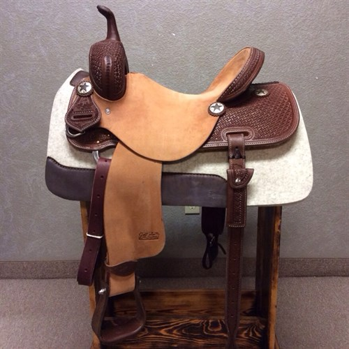 """14.5"""" Jeff Smith Barrel Saddle - Built with quality materials this Jeff Smith Barrel Saddle is built on a cutting tree, great deep seat and tall front end. Really sets you on your pockets and keeps you centered through the turns. Forward swung stirrups that move with ease you will not fight get out of the barrels and stay with your horse.  JSB-1"""