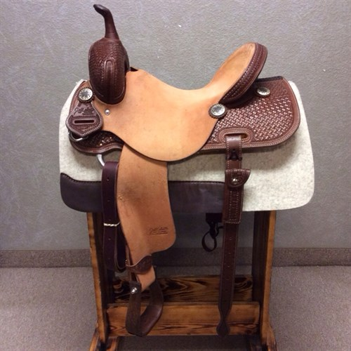 """15""""Jeff Smith Barrel Saddle - Built with quality materials this Jeff Smith Barrel Saddle is built on a cutting tree, great deep seat and tall front end. Really sets you on your pockets and keeps you centered through the turns. Forward swung stirrups that move with ease you will not fight get out of the barrels and stay with your horse.  JSB2"""