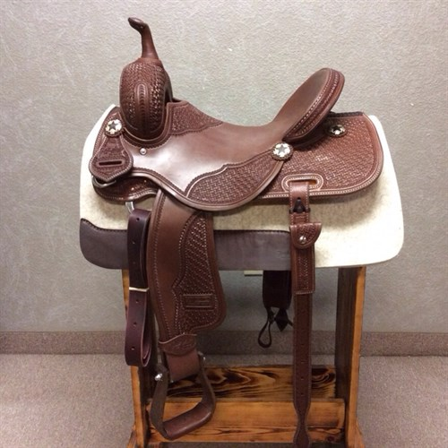 """15"""" Jeff Smith Barrel Saddle - Built with quality materials this Jeff Smith Barrel Saddle is built on a cutting tree, great deep seat and tall front end. Really sets you on your pockets and keeps you centered through the turns. Forward swung stirrups that move with ease you will not fight get out of the barrels and stay with your horse. JSB4"""