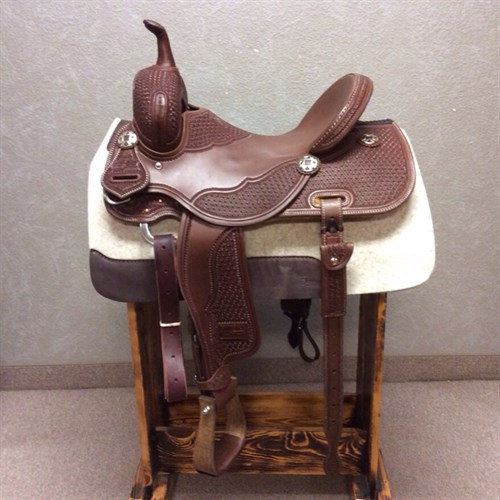 """15"""" Jeff Smith Barrel Saddle - Built with quality materials this Jeff Smith Barrel Saddle is built on a cutting tree, great deep seat and tall front end. Really sets you on your pockets and keeps you centered through the turns. Forward swung stirrups that move with ease you will not fight get out of the barrels and stay with your horse. JSB 5"""