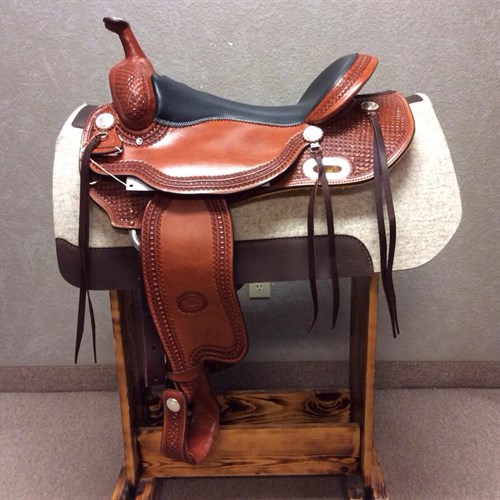 """17"""" #1855 Billy Cook Trail - When you buy a Billy Cook saddle, you know you're getting a unique, handmade saddle that shows its quality in every detail. Beautiful basket weave tooling, chestnut leather, and in-skirt rigging."""
