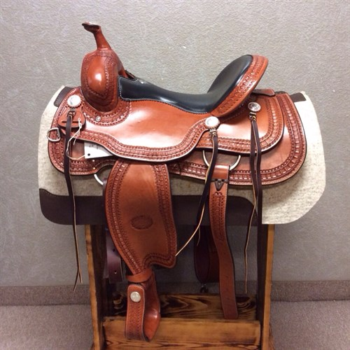 """16"""" #1777 Billy Cook Trail Saddle - Classic lines, quality craftsmanship, and unsurpassed comfort. That's what comes to mind with this Billy Cook trail saddle. Built for long rides, this saddle features a smooth quilted seat, inskirt rigging, and bell stirrups. Chestnut color and beautiful hand stamped waffle border. Treat yourself and your horse to a better ride with one of our most popular Billy Cook trail saddles!"""