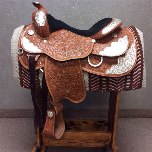 """16"""" Circle Y Show Saddle - In like NEW condition Circle Y Show Saddle includes floral tooling, diamond silver pattern, and a padded black suede seat. A great looking saddle!"""