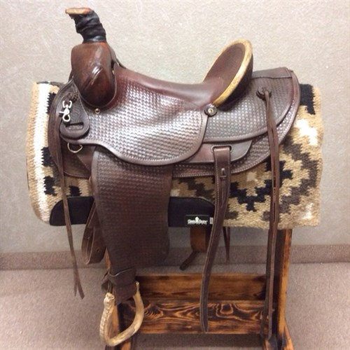 """16"""" Colorado Ranch Saddle - A great cowboy saddle with a deep hard seat and pencil roll. This saddle is equipped with strings and longer skirt for saddle bags and equipment."""