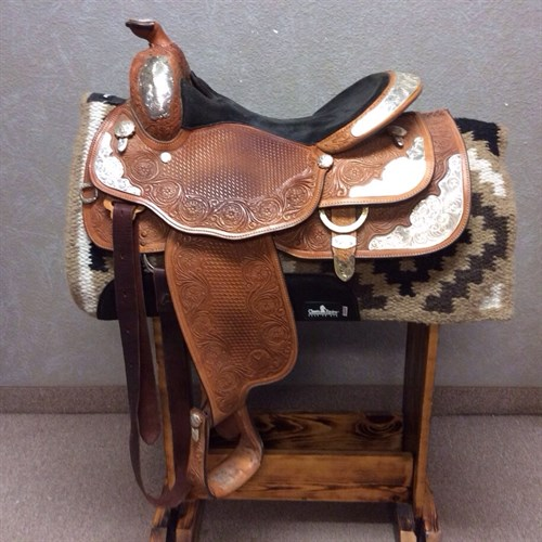 """16"""" Circle Y Show Saddle - Beautiful step up show saddle, quality silver and build from well known Circle Y! This saddle sits on a 16"""" Circle Y black suede equitation seat, with full QH bars and a nice shoulder flare."""