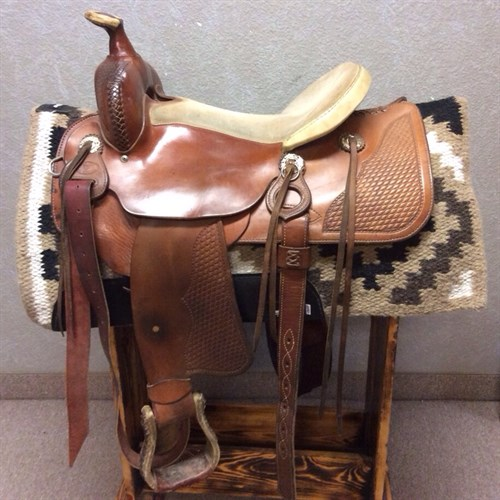 """16"""" HANDMADE Bud Tostrude Trail Saddle - Made in Webster, MN this genuine hand made Bud Tostrude trail saddle comes equipped with a light suede seat, basket weave tooling, strings and slotted conchos."""