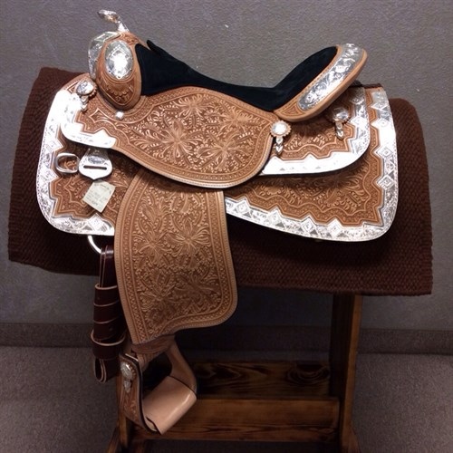 "16"" Dale Chavez Rio Show Saddle - Beautiful black suede padded seat, oak leaf and marigold tooling, and silver everywhere!! Full QH bars for lots of shoulder room, close contact skirt and in-skirt rigging for your comfort, and tons of silver perfect for any win picture!! (DC-20)"