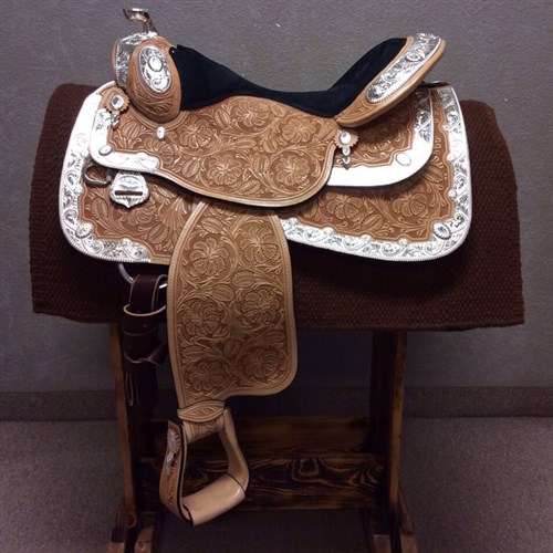 "16"" Dale Chavez Show Saddle  - Beautiful black suede padded seat, oak leaf and marigold tooling, and silver everywhere!! Full QH bars for lots of shoulder room, close contact skirt and in-skirt rigging for your comfort, and tons of silver perfect for any win picture!! (DC-21)"