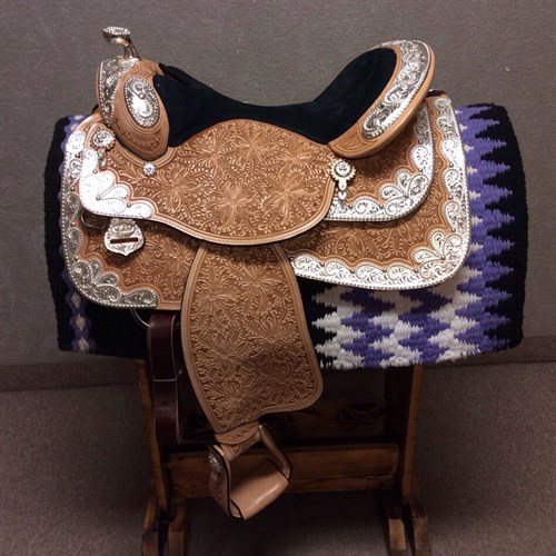 "16"" Dale Chavez show saddle. Oak leaf and marigold tooling, black suede equitation seat, this gives you a perfect pocket to sit in. Full quarter horse bars, skirt cut out for close contact, in skirt rigging, Hanley twist in the fenders for better leg position and comfort. Pay close attention to this beautiful silver! This will stand out in any show pen, beautiful Rio design. DC22"