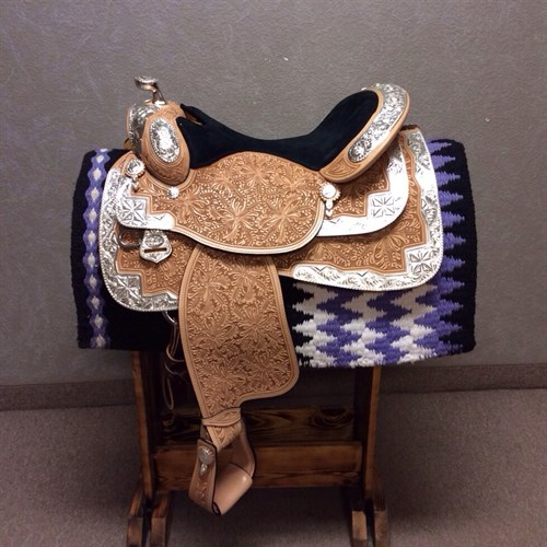 "16"" Dale Chavez Rio show saddle. Every Lady likes diamonds! Check out the silver pattern on this one! Black suede equitation seat to keep you tucked in nice. Skirt cut out for close contact, in skirt rigging. Nice oak leaf & marigold tooling pattern. Hanley twist in fenders to keep legs comfortable and in the right place for you. DC 23"