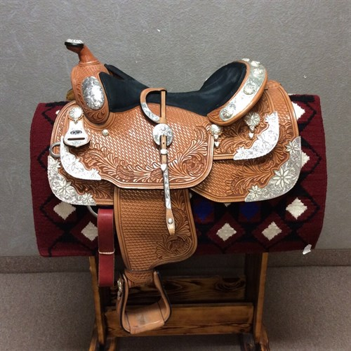 "Dale Chavez show saddle Very! Lightly used. 16 1/2"" equitation seat. Pretty 8 plate silver with floral accents. Cut out for close contact and pre turned fenders. Don't miss this deal it comes with the headstall too. C"