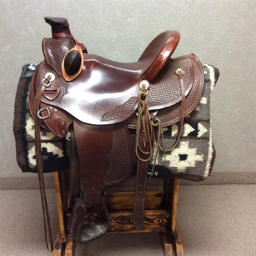 "Nice Dakota ranch saddle, 16"" seat, ready for hard work! Very good condition, nice big horn that's already wrapped plus bucking rolls in place. Don't miss this good deal. C"