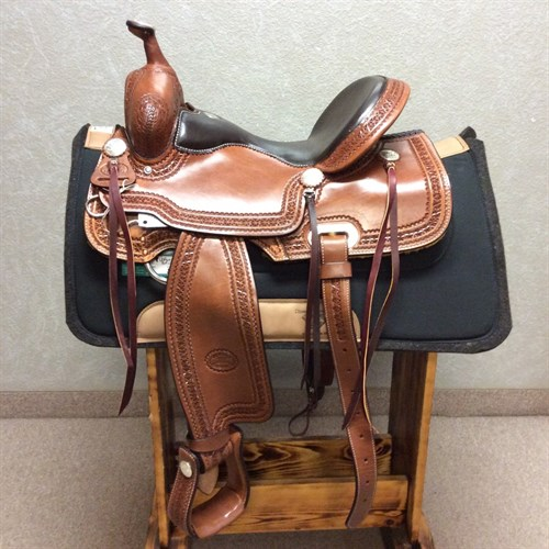 """15"""" #1538 Billy Cook Trail Saddle - When you buy a Billy Cook saddle, you know you're getting a unique, handmade saddle that shows its quality in every detail.   We love this new model---it's classic Billy Cook with a flashy twist. This trail saddle features a smooth padded quilted seat, tooled leather stirrups, and glossy hot oil leather with a star border. Ride in style and buy for quality when you choose Billy Cook."""
