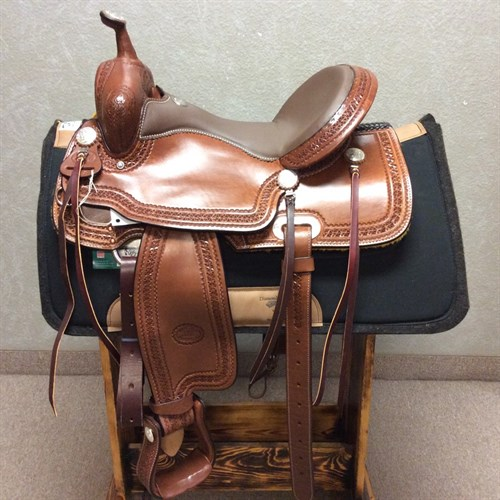 """16"""" #1583 Billy Cook Trail Saddle - When you buy a Billy Cook saddle, you know you're getting a unique, handmade saddle that shows its quality in every detail.   We love this new model---it's classic Billy Cook with a flashy twist. This trail saddle features a smooth padded quilted seat, tooled leather stirrups, and glossy hot oil leather with a star border. Ride in style and buy for quality when you choose Billy Cook."""