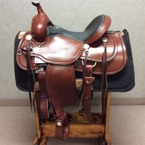 """15 1/2"""" #1784 Billy Cook Trail Saddle - Billy Cook proves his unique craftsmanship on the trail saddle with this creation.   Built especially with trail riders in mind, it's proven for comfort, and fashioned for beauty. This trail saddle features a smooth quilted seat, leather embossed stirrups, and glossy Chestnut leather with a stamped border.   Ride in style and buy for quality when you choose Billy Cook."""